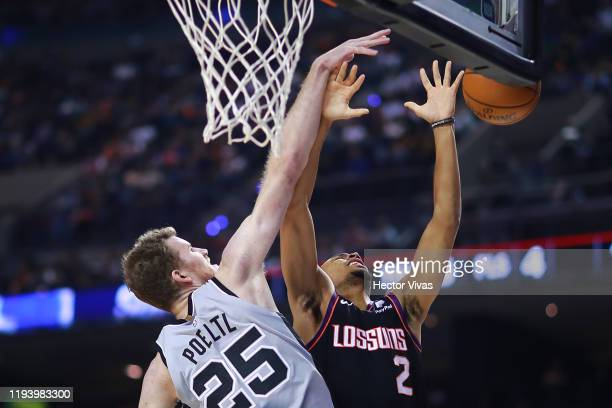 Elie Okobo of the Phoenix Suns shoots the ball against Jakob Poeltl of the San Antonio Spurs during a game between San Antonio Spurs and Phoenix Suns...
