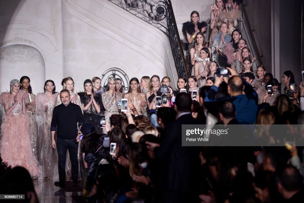 Elie Saab acknowledges the audience after the Elie Saab Spring Summer 2018 show as part of Paris Fashion Week on January 24, 2018 in Paris, France.
