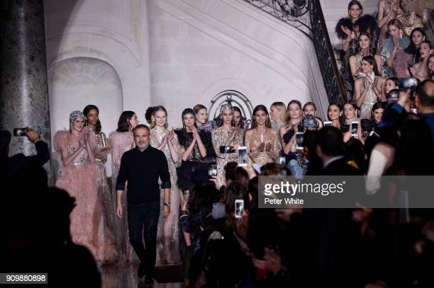 Elie Saab acknowledges the audience after the Elie Saab Spring Summer 2018 show as part of Paris Fashion Week on January 24 2018 in Paris France
