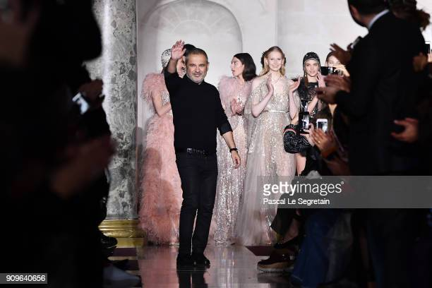 Elie Saab aknwoledges applause on the runway during the Elie Saab Spring Summer 2018 show as part of Paris Fashion Week on January 24 2018 in Paris...