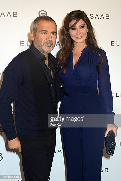 Elie Saab and a guest attend the Elie Saab show as part of the Paris Fashion Week Womenswear Spring/Summer 2014 at the Espace Ephemere des Tuileries...