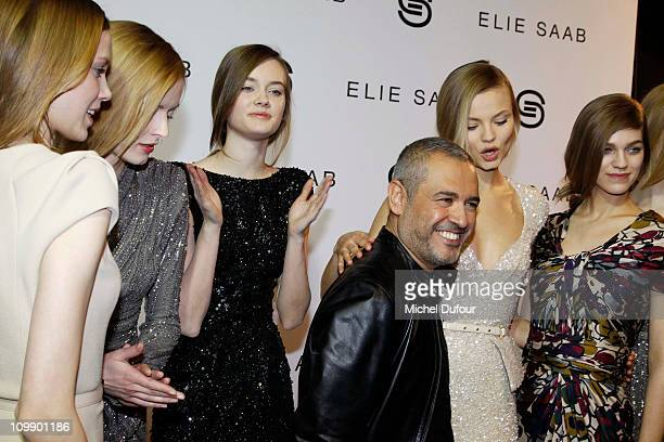 Elie Saab and models attend the Elie Saab Ready to Wear Autumn/Winter 2011/2012 show during Paris Fashion Week at Espace Ephemere Tuileries on March...