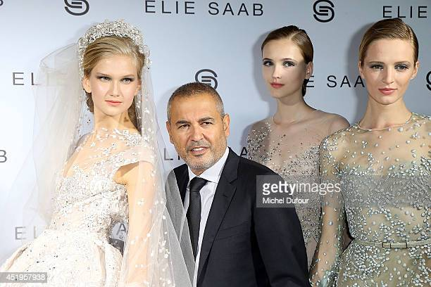 Elie Saab and models pose in backstage after the Elie Saab show as part of Paris Fashion Week Haute Couture Fall/Winter 20142015 at Pavillon Cambon...