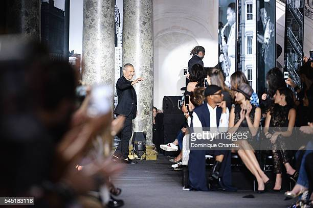 Elie Saab arrives on the runway during the Elie Saab Haute Couture Fall/Winter 20162017 show as part of Paris Fashion Week on July 6 2016 in Paris...