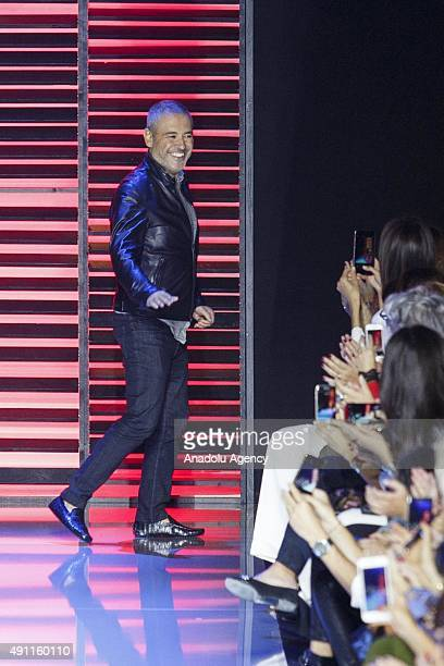 Elie Saab gestures after his show as part of the Paris Fashion Week Womenswear Spring/Summer 2016 on October 3 2015 in Paris France