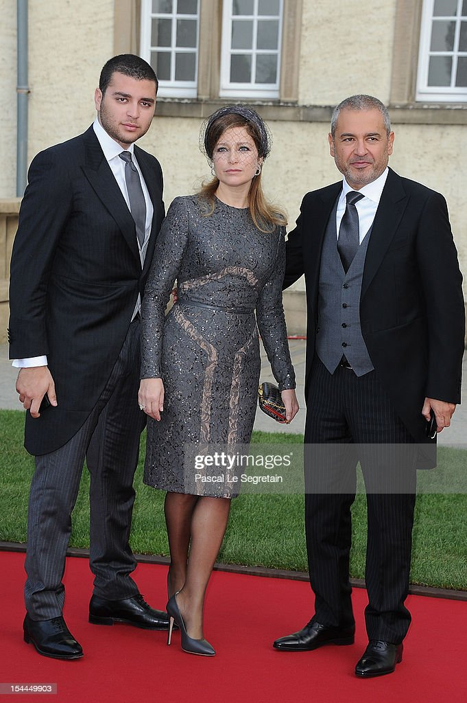 Elie Saab Jr (L), designer Elie Saab (R) and wife attend the wedding ceremony of Prince Guillaume Of Luxembourg and Princess Stephanie of Luxembourg at the Cathedral of our Lady of Luxembourg on October 20, 2012 in Luxembourg, Luxembourg. The 30-year-old hereditary Grand Duke of Luxembourg is the last hereditary Prince in Europe to get married, marrying his 28-year old Belgian Countess bride in a lavish 2-day ceremony.
