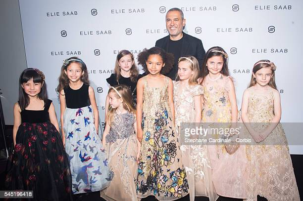 Elie Saab pose with models the Elie Saab Haute Couture Fall/Winter 20162017 show as part of Paris Fashion Week on July 6 2016 in Paris France