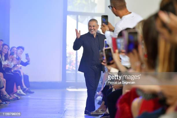 Elie Saab walks the runway during the Elie Saab Haute Couture Fall/Winter 2019 2020 show as part of Paris Fashion Week on July 03 2019 in Paris France