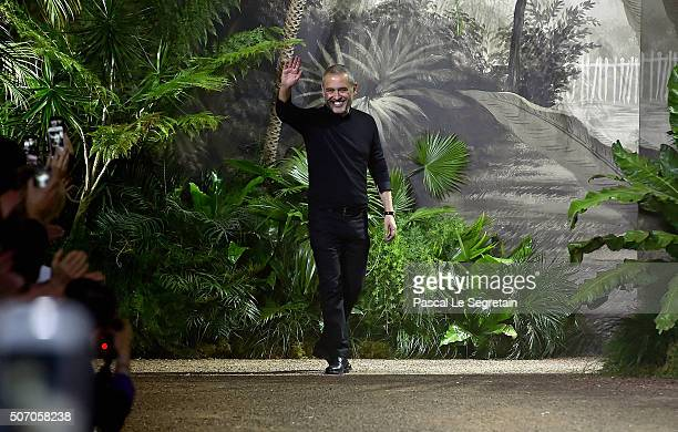 Elie Saab walks the runway during the Elie Saab Spring Summer 2016 show as part of Paris Fashion Week on January 27 2016 in Paris France