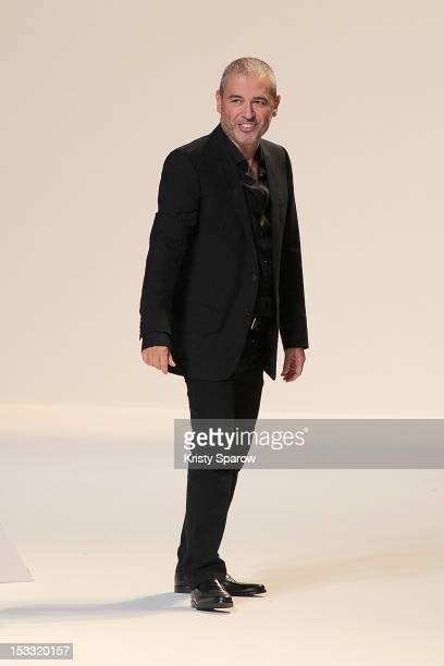 Elie Saab walks the runway during the Elie Saab Spring/Summer 2013 show as part of Paris Fashion Week at Espace Ephemere Tuileries on October 3, 2012...