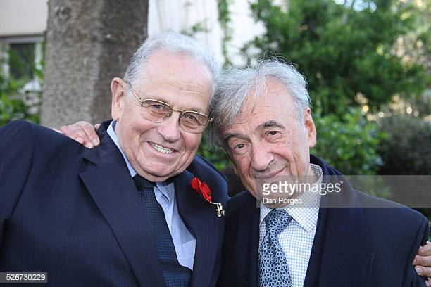 Elie Wiesel, 1986 Nobel Peace Prize Laureate, posing with his friend Joseph Ciechanover an Israeli diplomat and businessman who is wearing on his...