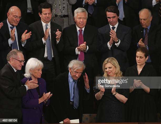 Elie Wiesel is acknowledged while standing with Sara Netanyahu while Israeli Prime Minister Benjamin Netanyahu delivered a speech a joint meeting of...