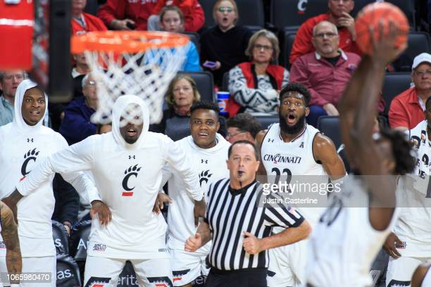 Eliel Nsoseme of the Cincinnati Bearcats and his team watch as Mamoudou Diarra dunks the ball in the game against the ArkansasPine Bluff Golden Lions...