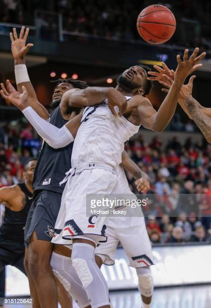 Eliel Nsoseme of the Cincinnati Bearcats reaches for the loose ball against Chad Brown of the UCF Knights at BB&T Arena on February 6, 2018 in...