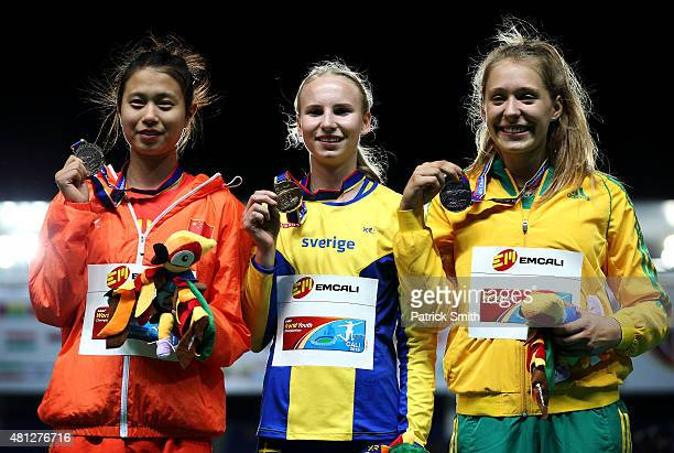 Elienor Werner of Sweden gold medal Phillipa Hajdasz of Australia silver medal and Qiaoling Chen of China silver medal celebrate on the podium after...