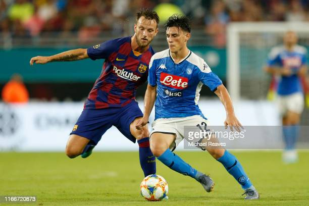 Elif Elmas of Napoli dribbles with the ball against Ivan Rakitic of FC Barcelona during a preseason friendly match at Hard Rock Stadium on August 07...