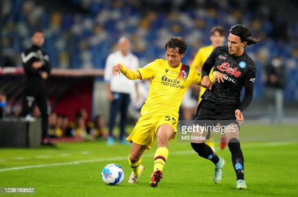Elif Elmas of SSC Napoli competes for the ball with Emanuel Vignato of Bologna FC ,during the Serie A match between SSC Napoli and Bologna FC at...