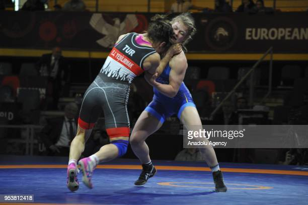 Elif Jale Yesilirmak of Turkey competes with Svetlana Lipatova of Russia in the Womens 59kg category match within the 2018 European Wrestling...