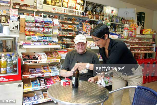 Elif Mutlu waits on a customer in the kiosk in centre of KampLintfort Germany on Monday August 23 2005 Two years ago Ahmed Mutlu moved to...