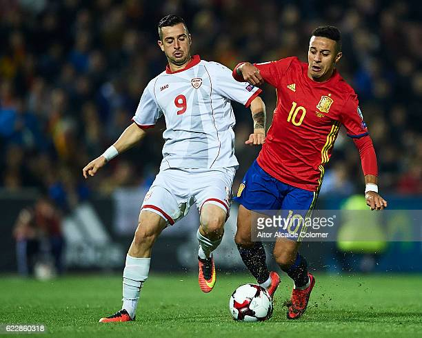 Elija Nestorovski of FYR Macedonia competes for the ball with Thiago Alcantara of Spain during the FIFA 2018 World Cup Qualifier between Spain and...