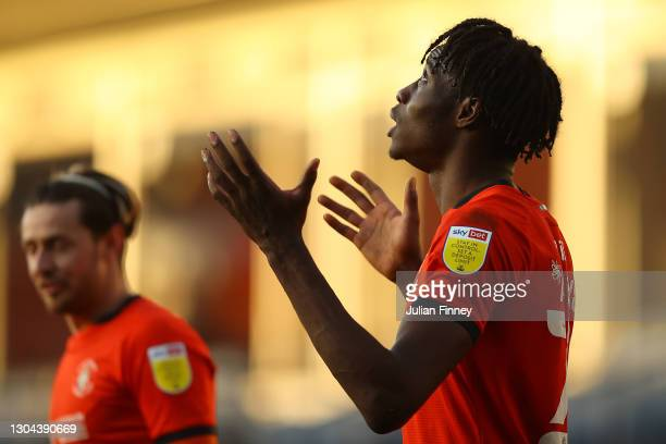 Elijah Adebayo of Luton Town celebrates after scoring his team's third goal during the Sky Bet Championship match between Luton Town and Sheffield...