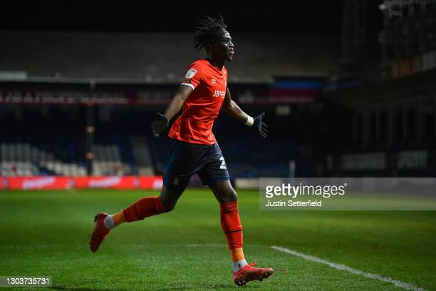Elijah Adebayo of Luton Town celebrates after scoring their sides first goal during the Sky Bet Championship match between Luton Town and Millwall at...
