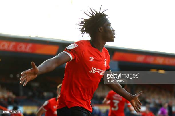 Elijah Adebayo of Luton Town celebrates after scoring their side's third goal during the Sky Bet Championship match between Luton Town and Sheffield...