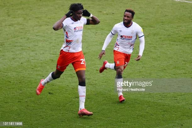 Elijah Adebayo of Luton Town celebrates after scoring their team's third goal with teammate Kazenga LuaLua during the Sky Bet Championship match...