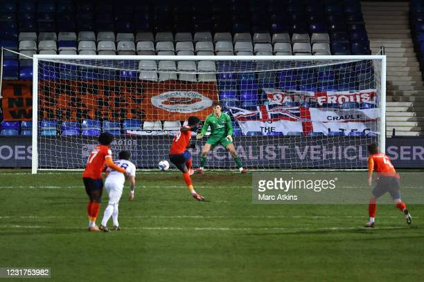 Elijah Adebayo of Luton Town scores their 2nd goal from the penalty spot during the Sky Bet Championship match between Luton Town and Coventry City...