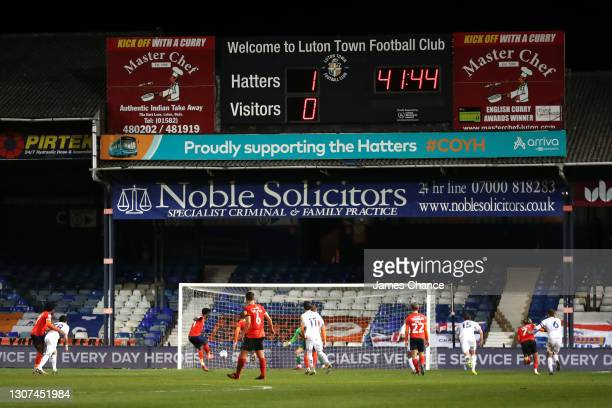 Elijah Adebayo of Luton Town scores their team's second goal from the penalty spot during the Sky Bet Championship match between Luton Town and...