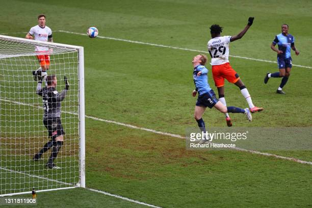 Elijah Adebayo of Luton Town scores their team's third goal during the Sky Bet Championship match between Wycombe Wanderers and Luton Town at Adams...
