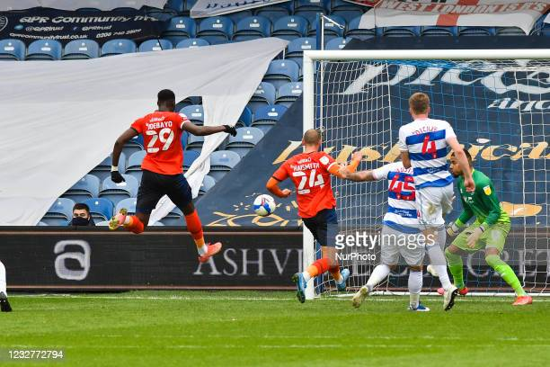 Elijah Adebayo of Luton town shoots at goal during the Sky Bet Championship match between Queens Park Rangers and Luton Town at Loftus Road Stadium,...