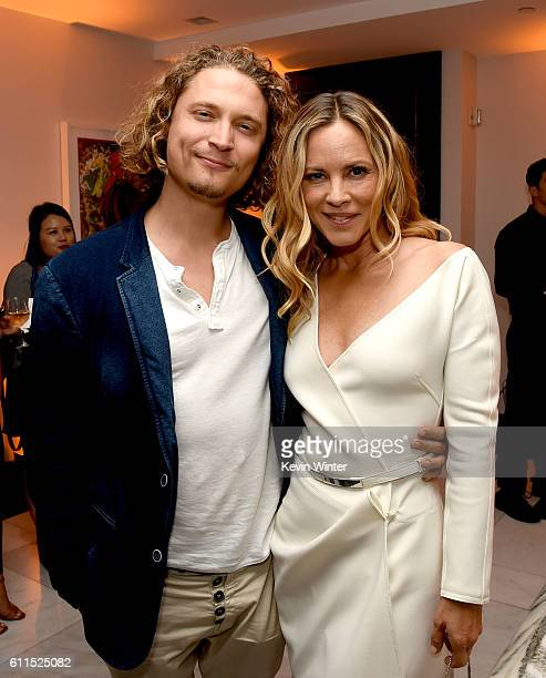 Elijah AllanBlitz and actress Maria Bello pose at the after party for the premiere screening of Amazon's 'Goliath' at The London on September 29 2016...