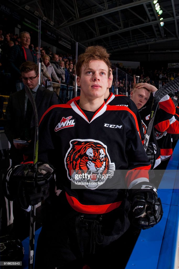 Elijah Brown #15 of the Medicine Hat Tigers stands on the bench against the Kelowna Rockets at Prospera Place on January 30, 2018 in Kelowna, Canada.