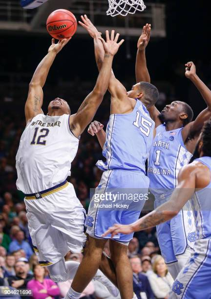 Elijah Burns of the Notre Dame Fighting Irish shoots the ball against Garrison Brooks of the North Carolina Tar Heels at Purcell Pavilion on January...