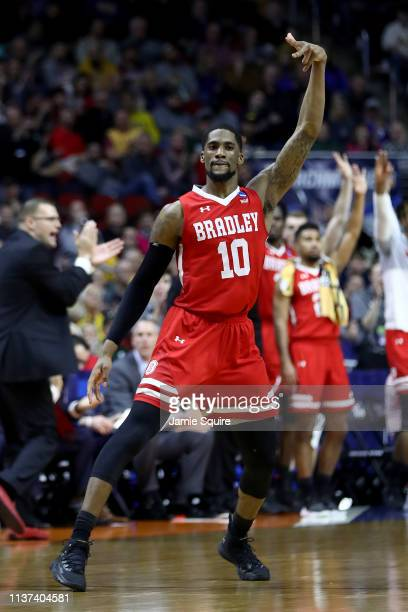 Elijah Childs of the Bradley Braves celebrates after a three point basket against the Michigan State Spartans during their game in the First Round of...