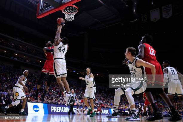 Elijah Childs of the Bradley Braves takes a shot over Nick Ward of the Michigan State Spartans during their game in the First Round of the NCAA...