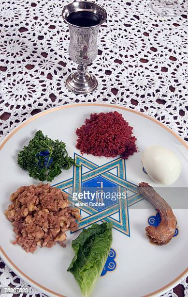 elijah cup and seder plate - passover seder plate stock pictures, royalty-free photos & images