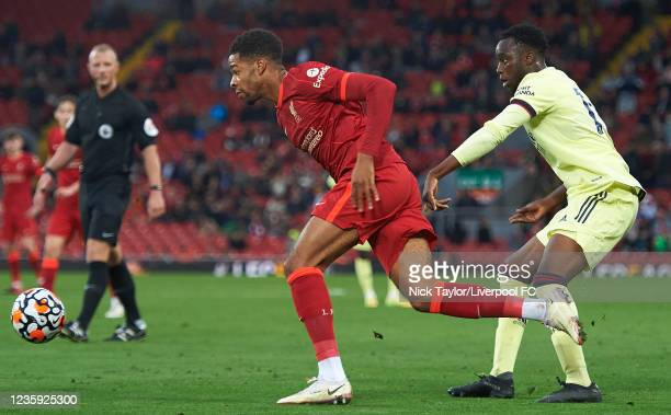 Elijah Dixon-Bonner of Liverpool and James Olayinka of Arsenal in action during the PL2 game at Anfield on October 16, 2021 in Liverpool, England.