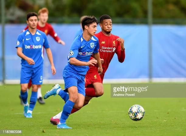 Elijah Dixon-Bonner of Liverpool with Elias Sierra of KRC Genk during the UEFA Youth League match between Genk U19 and Liverpool U19 at KRC Genk...
