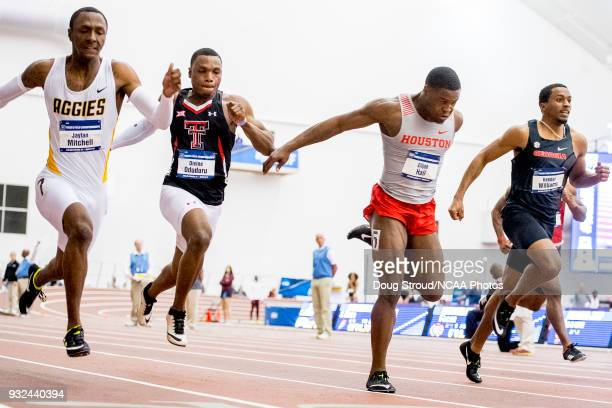 Elijah Hall of the University of Houston lunges toward the finish line placing 2nd in the Mens 60 Meter Dash with Jaylen Bacon of Arkansas State...
