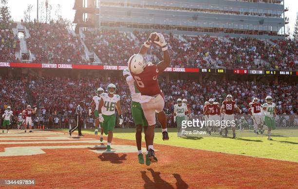 Elijah Higgins of the Stanford Cardinal makes the tying touchdown catch at the end of the fourth quarter while covered by DJ James of the Oregon...