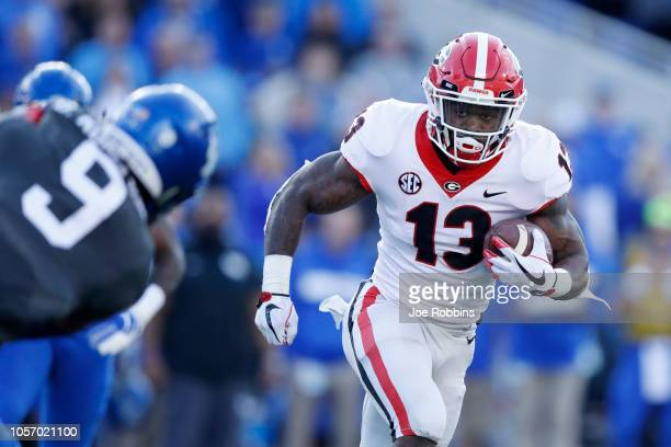 Elijah Holyfield of the Georgia Bulldogs runs the ball in the second quarter of the game against the Kentucky Wildcats at Kroger Field on November 3...