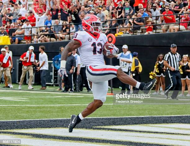 Elijah Holyfield of the Georgia Bulldogs rushes for a touchdown against the Vanderbilt Commodores during the second half at Vanderbilt Stadium on...
