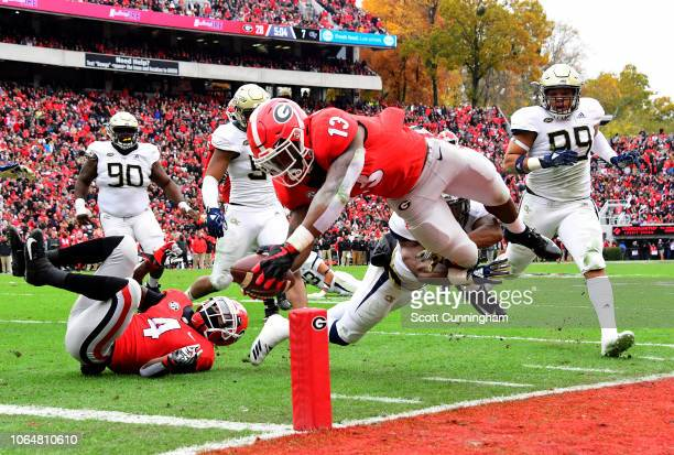 Elijah Holyfield of the Georgia Bulldogs scores a second quarter touchdown against the Georgia Tech Yellow Jackets on November 24 2018 at Sanford...