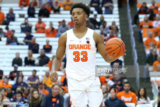 Elijah Hughes of the Syracuse Orange controls the ball against the St Rose Golden Knights during the second half at the Carrier Dome on October 25...