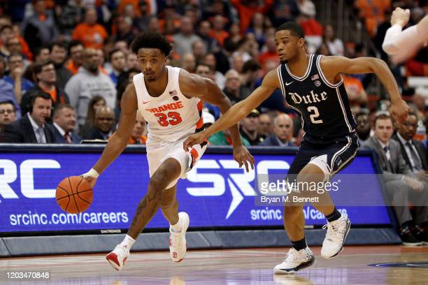 Elijah Hughes of the Syracuse Orange dribbles as Cassius Stanley of the Duke Blue Devils guards him during the second half of an NCAA basketball game...