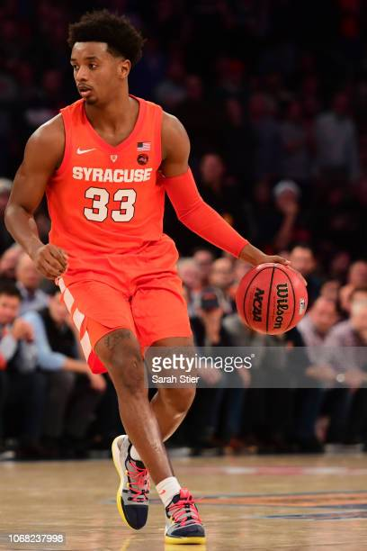 Elijah Hughes of the Syracuse Orange dribbles down the court in the second half of the game against Connecticut Huskies during the 2k Empire Classic...