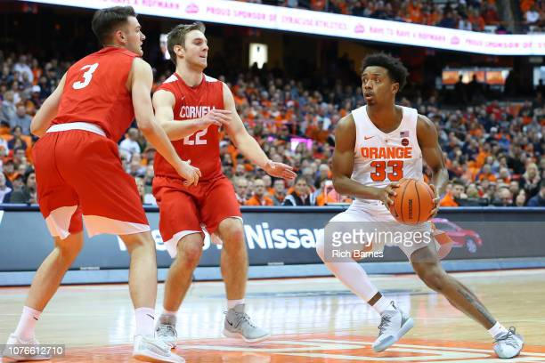 Elijah Hughes of the Syracuse Orange drives to the basket as Jimmy Boeheim and Josh Warren of the Cornell Big Red defend during the second half at...