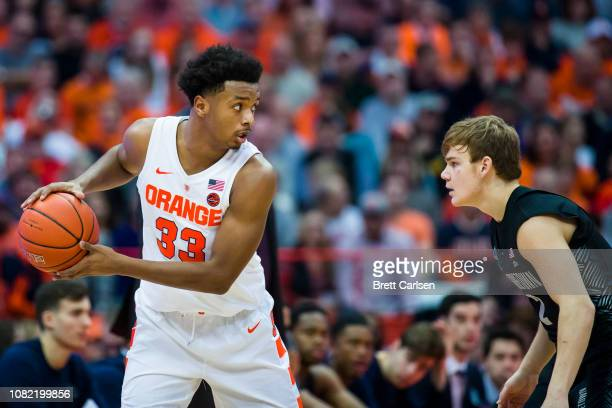 Elijah Hughes of the Syracuse Orange handles the ball during the game against Mac McClung of the Georgetown Hoyas at the Carrier Dome on December 8...